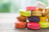 French colorful macarons on wood table — Stock Photo