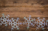 Snowflakes lights on wood background — Stock Photo