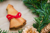 Christmas wreath with cookies over Wooden Background — Stock Photo