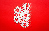 Vintage Christmas postcard with true paper snowflakes — Stock Photo
