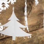 Christmas decorations snowflake ,christmas tree paper hanging ov — Stock Photo #60185091