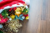 Santa Hat with Christmas decorations on wooden background — Stock Photo