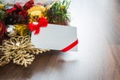 Christmas card and Santa Hat with decorations on wooden backgrou — Stock Photo