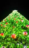 Christmas tree on black background — Stock Photo