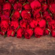 Rose on wooden background — Stock Photo #64746571