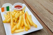 French fries on wood table — Stock Photo