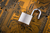 Protection concept : security lock on computer circuit board — Stock Photo