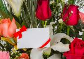 Colorful Bunch of flowers with card — Stock Photo