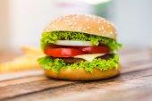 Hamburger on wood table ,sun flare filter effect — Stock Photo