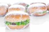 Wrapping Hamburger on white background — Stock Photo