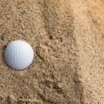 Golf ball in sand bunker — Stock Photo #75924433