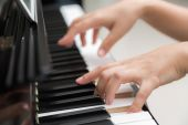 Woman hands  playing piano — Stock Photo