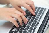 Business woman hand typing on laptop keyboard — Stock Photo