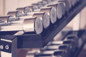 Sports dumbbells  ( Filtered image processed vintage effect. ) — Stock Photo