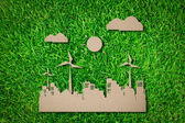 Paper cut of  eco friendly city on grass — Stock Photo