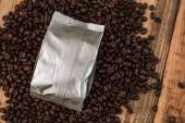 New coffee foil bag on wood table — Stock Photo