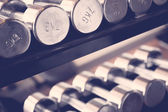 Sports dumbbells  in gym — Stock Photo