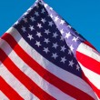 American flag over blue sky — Stock Photo #78596666