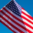 American flag over blue sky — Stock Photo #78596672
