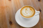 Latte Coffee art on the wooden table — Stock Photo