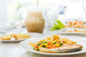 Salmon steak with salad and French fries — Stock Photo
