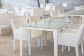 White tables and chairs — Stock Photo