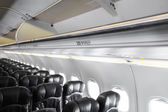 Airplane seats in cabin — Stock Photo