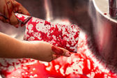 Hands holding bloody knife — Stock Photo