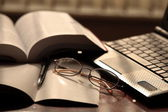 Laptop, notebook and glasses. — Stock Photo