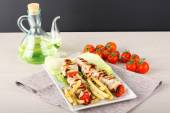 Skewers of meat and oil bottle — Stock Photo