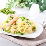 Pasta with salmon and peas — Stock Photo #64731793