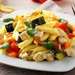 Pasta with swordfish, zucchini and cherry tomatoes — Stock Photo #70474873