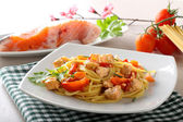 Pasta with fresh salmon, tomato and chives — Stock Photo