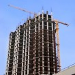 High-rise building under construction and crane — Stock Photo #73974501