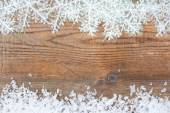 Wooden background with winter snow on the border and copyspace — Stock Photo