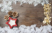 Wooden background with winter snow  and Christmas Decorations on — Stockfoto