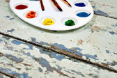 Set of watercolor aquarell rainbow paints and brushes on vintage — Stock Photo