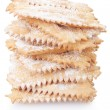 Chiacchiere, italian Carnival pastry pile on white — Stock Photo #65721169