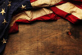 Old American flag background for Memorial Day or 4th of July — Stock Photo