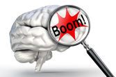 Boom explosion word on magnifying glass and human brain — Stock Photo