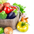 Постер, плакат: Fresh vegetables in wooden bucket with greens