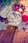 Christmas balls with tinsel and firtree — Stock Photo