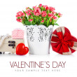 Bunch roses and gift on valentines day — Stock Photo #62099897