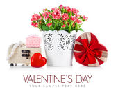 Bunch roses and gift on valentines day — Stock Photo