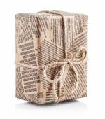 Box packaged newspaper with bow of rope — Stock Photo