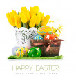 Easter eggs in basket with yellow tulips — Stock Photo #63703983