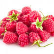 Fresh berry raspberries with green leaves — Stock Photo #65597403
