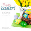 Easter eggs in basket with yellow tulips — Stock Photo #66412743