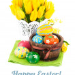 Easter eggs in basket with yellow tulips — Stock Photo #66412931