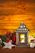 Christmas lantern with fir and tinsel — Stock Photo